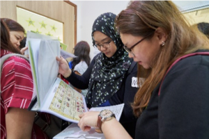 Participants perusing the centre's weekly menu
