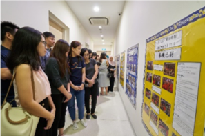 Participants reading posters