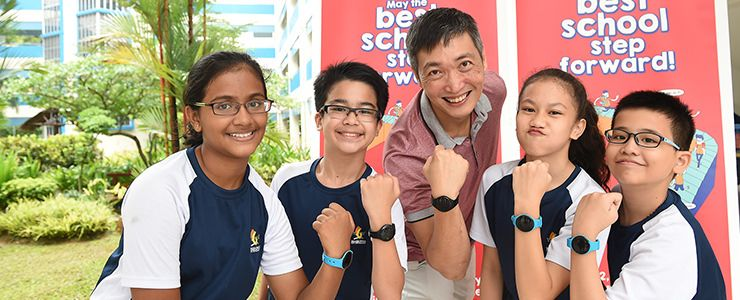 Primary school students wearing HPB steps tracker